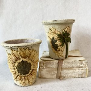 Learn how to work with the Iron Orchid Design sunflower mould, air clay and Fusion Mineral Paints while making a pot.